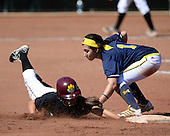 Michigan Wolverines Softball infielder Abby Ramirez (1) applies the tag as the ball pops out to Breanna Chavez (2) sliding in during a game against the Bethune-Cookman on February 9, 2014 at the USF Softball Stadium in Tampa, Florida.  Michigan defeated Bethune-Cookman 12-1.  (Copyright Mike Janes Photography)