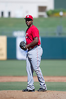 Cincinnati Reds pitcher Wendolyn Bautista prepares to deliver a pitch to the plate during an Instructional League game against the Kansas City Royals on October 2, 2017 at Surprise Stadium in Surprise, Arizona. (Zachary Lucy/Four Seam Images)