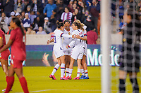 HOUSTON, TX - JANUARY 31: Christen Press #20, Tobin Heath #7, Lindsey Horan #9 and Jessica McDonald #14 of the United States celebrate a goal together during a game between Panama and USWNT at BBVA Stadium on January 31, 2020 in Houston, Texas.