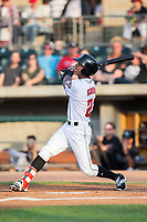 Miles Gordon (23) of the Billings Mustangs follows through on his swing against the Missoula Osprey at Dehler Park on August 21, 2017 in Billings, Montana.  The Osprey defeated the Mustangs 10-4.  (Brian Westerholt/Four Seam Images)