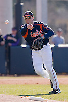 Third baseman Steven Proscia #19 of the Virginia Cavaliers makes a throw to fist base at Clark-LeClair Stadium on February 19, 2010 in Greenville, North Carolina.   Photo by Brian Westerholt / Four Seam Images