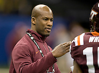 Virginia Tech defensive secondary coach Torrian Gray is pictured talking with his players before Sugar Bowl game against Michigan at Mercedes-Benz SuperDome in New Orleans, Louisiana on January 3rd, 2012.  Michigan defeated Virginia Tech, 23-20 in first overtime.