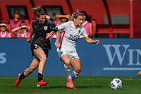 BRIDGEVIEW, IL - JULY 18: Arin Wright #3 of the Chicago Red Stars and Eugenie Le Sommer #9 of the OL Reign battle for the ball during a game between OL Reign and Chicago Red Stars at SeatGeek Stadium on July 18, 2021 in Bridgeview, Illinois.