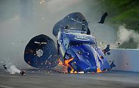 Jun. 18, 2011; Bristol, TN, USA: NHRA pro mod driver Roger Burgess crashes alongside Kenny Lang during eliminations at the Thunder Valley Nationals at Bristol Dragway. Mandatory Credit: Mark J. Rebilas-