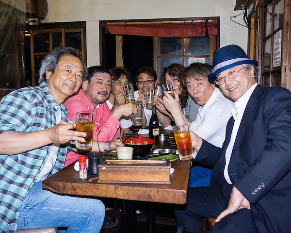 A group of musicians having a nomikai after a performance.