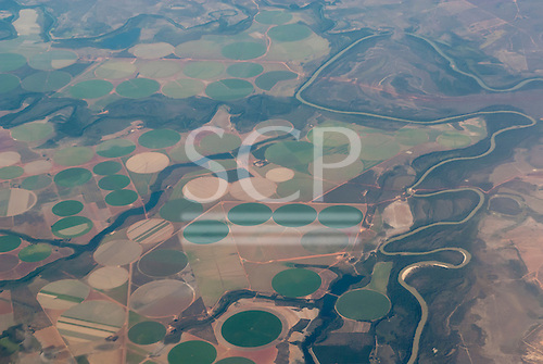 Goias State, Brazil. Aerial view of huge irrigated agriculture with circular irrigation pattern.