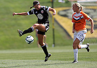 BOYDS, MARYLAND - July 22, 2012:  Holly King (16) of DC United Women pulls in a cross in front of Samantha Huecker (21) of the Charlotte Lady Eagles during the W League Eastern Conference Championship match at Maryland Soccerplex, in Boyds, Maryland on July 22. DC United Women won 3-0.