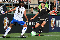 19 July 2009: Erika of the FC Gold Pride crosses the ball from near the corner while checked by Erika Sutton of the Boston Breakers during the game at Buck Shaw Stadium in Santa Clara, California.  The Boston Breakers defeated the FC Gold Pride, 1-0.