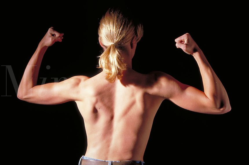 Very Fit Woman, showing nude muscular back and arms. health, fitness, strong, powerful, figure study. Barbara Gehring. Boulder Colorado.