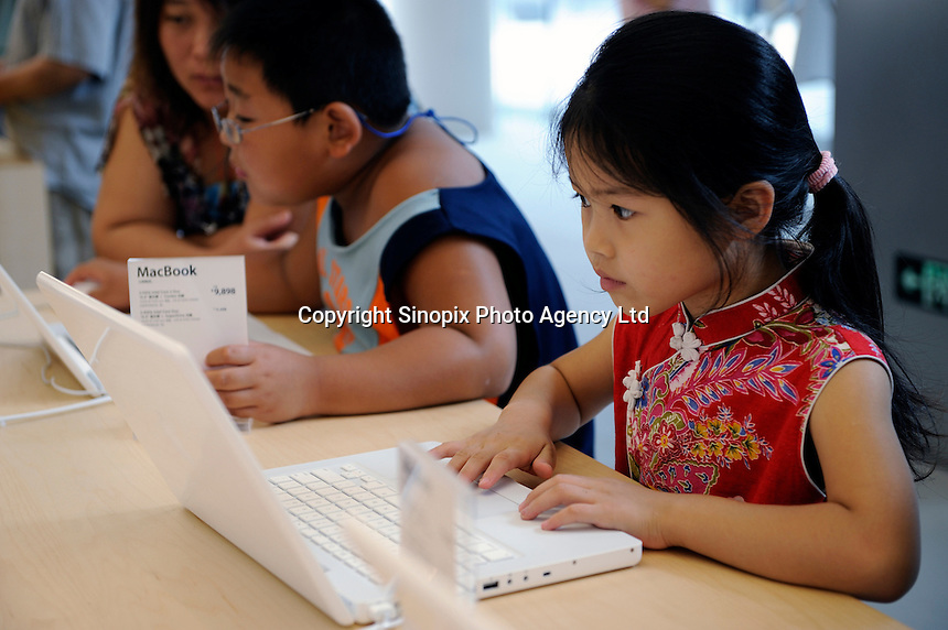 Apple Retail Store, at a new retail development called the Village at Sanlitun, attracts many locals in Beijing, China. Apple unveiled its first store in China to the media on July. But it does not have the iPhone, a common product in Beijing where it's smuggled in, as the company is still trying to hammer out an agreement with Chinese carriers..