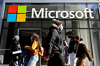 NEW YORK, NEW YORK - MARCH 10: People walk around Microsoft store on March 10, 2021, in New York. The Nasdaq Composite continued falling more than half a percent during the day also the move away from Apple Inc, Amazon.com Inc , Facebook Inc, Tesla Inc and Microsoft Corp, falling during the day, helped small-cap stocks rise more than double the gains of the S&P 500. (Photo by John Smith/VIEWpress)