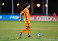 LAKE BUENA VISTA, FL - JULY 18: Zarek Valentin #4 of the Houston Dynamo looks for options during a game between Houston Dynamo and Portland Timbers at ESPN Wide World of Sports on July 18, 2020 in Lake Buena Vista, Florida.