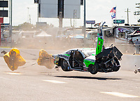 Oct 4, 2020; Madison, Illinois, USA; NHRA pro stock driver Kenny Delco flips over and crashes during the Midwest Nationals at World Wide Technology Raceway. Delco would be unhurt in the crash. Mandatory Credit: Mark J. Rebilas-USA TODAY Sports