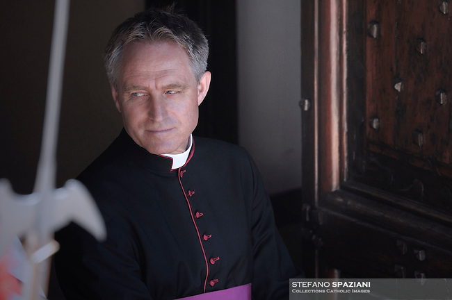 Monsignor Georg Gaenswein private secretary to Pope Benedict XVI faces pilgrims gathered in the courtyard of his summer residence of Castelgandolfo, 40 km southeast of Rome, upon his arrival for a weekly general audience on August 31, 2011.