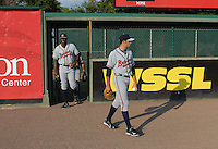 Starting pitcher Sean Gilmartin (2) of the Rome Braves leaves the bullpen with pitching coach Derrick Lewis prior to a game against the Greenville Drive on August 16, 2011, at Fluor Field at the West End in Greenville, South Carolina. Gilmartin was Atlanta's first-round pick (No. 28 overall) in the 2011 First-Year Player Draft out of Florida State. Making his second start of the season, he pitched four scoreless innings, giving up one hit and striking out four. (Tom Priddy/Four Seam Images)