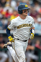 Michigan Wolverines catcher Joe Donovan (0) runs to first base during Game 1 of the NCAA College World Series against the Texas Tech Red Raiders on June 15, 2019 at TD Ameritrade Park in Omaha, Nebraska. Michigan defeated Texas Tech 5-3. (Andrew Woolley/Four Seam Images)