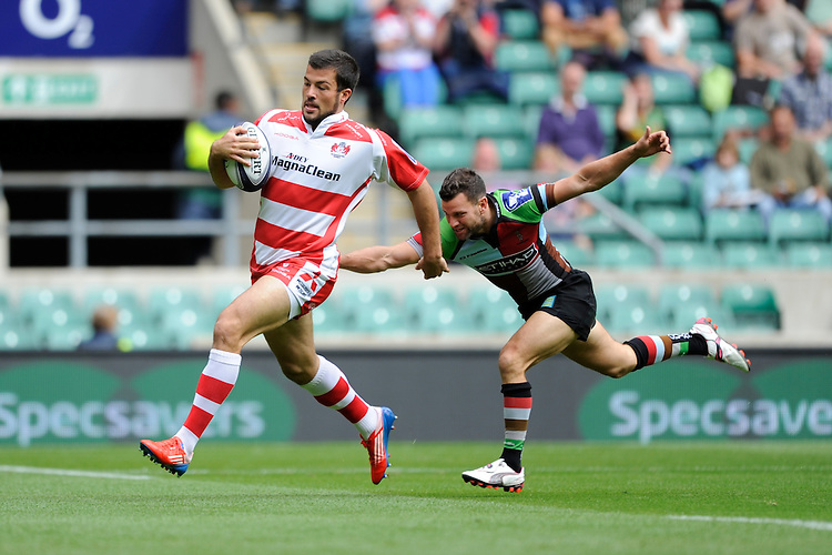Gareth Evans of Gloucester Rugby 7s accelerates away from Karl Dickson of Harlequins 7s to score a try during the World Club 7s at Twickenham on Sunday 18th August 2013 (Photo by Rob Munro)