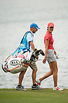 TAOYUAN, TAIWAN - OCTOBER 28:  Michelle Wie of USA chats with her caddie Brendan Woolley on the 14th hole during the day four of the Sunrise LPGA Taiwan Championship at the Sunrise Golf Course on October 28, 2012 in Taoyuan, Taiwan.  Photo by Victor Fraile / The Power of Sport Images