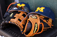 Michigan Wolverines baseball hats and gloves before the NCAA season opening baseball game against the Texas State Bobcats on February 14, 2014 at Bobcat Ballpark in San Marcos, Texas. Texas State defeated Michigan 8-7 in 10 innings. (Andrew Woolley/Four Seam Images)