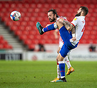 19th December 2020; Bet365 Stadium, Stoke, Staffordshire, England; English Football League Championship Football, Stoke City versus Blackburn Rovers; Steven Fletcher of Stoke City is tackled with a high boot by Bradley Johnson of Blackburn Rovers