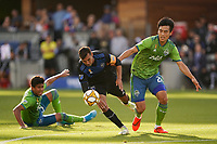SAN JOSE, CA - SEPTEMBER 29: Chris Wondolowski #8 of the San Jose Earthquakes is marked by Kim Kee-hee #20 of the Seattle Sounders FC during a Major League Soccer (MLS) match between the San Jose Earthquakes and the Seattle Sounders on September 29, 2019 at Avaya Stadium in San Jose, California.