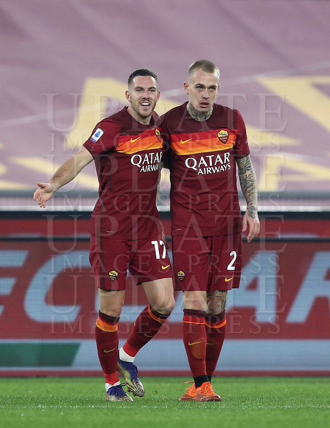 Football, Serie A: AS Roma - Cagliari calcio, Olympic stadium, Rome, December 23, 2020. <br /> Roma's Jordan Veretout (l) celebrates after scoring with his teammate Rick Karsdorp (r) during the Italian Serie A football match between Roma and Cagliari at Rome's Olympic stadium, on December 23, 2020.  <br /> UPDATE IMAGES PRESS/Isabella Bonotto