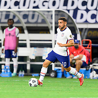 DALLAS, TX - JULY 25: Cristian Roldan #10 of the United States brings the ball up the field during a game between Jamaica and USMNT at AT&T Stadium on July 25, 2021 in Dallas, Texas.