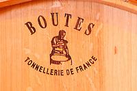 A barrel -  Boutes - Tonnellerie de France. The barrel maker cooper has burnt his brand on the side of the barrel - Chateau La Grave Figeac, Saint Emilion, Bordeaux
