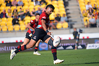 Richie Mo'unga kicks during the Super Rugby Aotearoa match between the Hurricanes and Crusaders at Sky Stadium in Wellington, New Zealand on Sunday, 11 April 2020. Photo: Dave Lintott / lintottphoto.co.nz