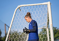 KASHIMA, JAPAN - AUGUST 1: Alyssa Naeher #1 of the USWNT rests for a moment during a training session at the practice field on August 1, 2021 in Kashima, Japan.