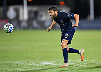 LAKE BUENA VISTA, FL - JULY 26: Ilie Sánchez of Sporting KC heads the ball to a teammate during a game between Vancouver Whitecaps and Sporting Kansas City at ESPN Wide World of Sports on July 26, 2020 in Lake Buena Vista, Florida.