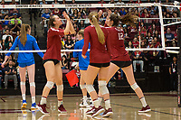 STANFORD, CA - NOVEMBER 17: Stanford, CA - November 17, 2019: Madeleine Gates, Audriana Fitzmorris, Jenna Gray at Maples Pavilion. #4 Stanford Cardinal defeated UCLA in straight sets in a match honoring neurodiversity. during a game between UCLA and Stanford Volleyball W at Maples Pavilion on November 17, 2019 in Stanford, California.