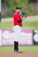 Kannapolis Intimidators starting pitcher Sean Bierman (26) looks to his catcher for the sign against the Greenville Drive at CMC-Northeast Stadium on April 6, 2014 in Kannapolis, North Carolina.  The Intimidators defeated the Drive 8-5.  (Brian Westerholt/Four Seam Images)