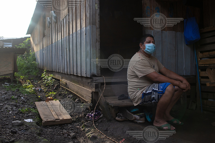 Jose Alberto Garcia, 38, sits outside his unit at the Single-Family Transitional Shelters. He states: ''Because of what happened (the eruption), we rather not risk it. If something were to happen to the kids, it just, would be too hard. Yes, here we have to buy everything, but some of the other affected families that accepted homes in the La Dignidad housing complex give me odd jobs every once in a while so we can get by. I mow the lawn, clean whatever they need. Itís very hard here, but still, we try our best.''