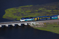 aerial photograph of the Coaster commuter train, San Diego, California, crossing Los Penasquitos Creek at Torrey Pines State Beach, San Diego County, California