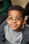 Education Elementary school Grade 2 closeup portrait of boy vertical wearing eyeglasses