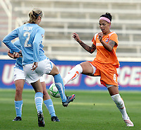 Sky Blue FC forward Natasha Kai (6) beats Chicago Red Star defender Marian Dalmy (2) to the ball.  The Sky Blue FC defeated the Chicago Red Stars 2-0 at Toyota Park in Bridgeview, IL on May 10, 2009.