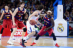Real Madrid's Sergio Llull and FC Barcelona Lassa's Ante Tomic and Tyrese Rice during Liga Endesa match between Real Madrid and FC Barcelona Lassa at Wizink Center in Madrid, Spain. March 12, 2017. (ALTERPHOTOS/BorjaB.Hojas)