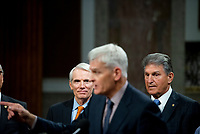 United States Senator Rob Portman (Republican of Ohio), left, and United States Senator Joe Manchin III (Democrat of West Virginia), right, listen while United States Senator Bill Cassidy (Republican of Louisiana), center, makes remarks after the vote on the motion to invoke cloture to proceed to the consideration of H.R. 3684, the INVEST in America Act on Capitol Hill in Washington, DC on Wednesday, July 28, 2021. The vote to begin discussion of the bipartisan infrastructure bill agreed to by the White House, was 67 to 32. If passed, the bill would invest close to $1 trillion in roads, bridges, ports and other infrastructure without a major tax increase.<br /> Credit: Rod Lamkey / CNP / MediaPunch