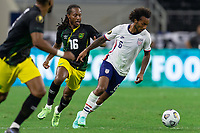 DALLAS, TX - JULY 25: Gianluca Busio #6 of the United States battle for a ball during a game between Jamaica and USMNT at AT&T Stadium on July 25, 2021 in Dallas, Texas.