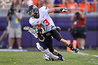 Oklahoma State wide receiver David Glidden (13) is tackled by TCU safety Derrick Kindred (26) during an NCAA football game, Saturday, October 18, 2014 in Fort Worth, Tex. TCU leads Oklahoma State 28-9 at the halftime. (Mo Khursheed/TFV Media via AP Images)