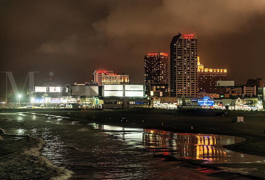 Atlantic City beach and casinos at night, New Jersey, USA
