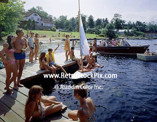 Capri Village Resort, Lake George, NY. Group of teenagers and families on the dock.