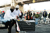 Racers take off at the beginning of the second annual Idiotarod in New York City on January 29, 2005.<br /> <br /> The playfully named Idiotarod is a race between teams of five people pulling stylized shopping carts, starting in the borough of Brooklyn and ending in Manhattan.  Teams are given only checkpoints and must devise their own routes to make it to each finish line.  Awards are not only given to the first finishers but also to those with the best costumes, best bribes, and most creative sabotage techniques.  Imbibing of alcohol or other substances is neither required nor discouraged and the race is administered by the mysterious group C.O.B.R.A. (Carts of Brooklyn Racing Association).