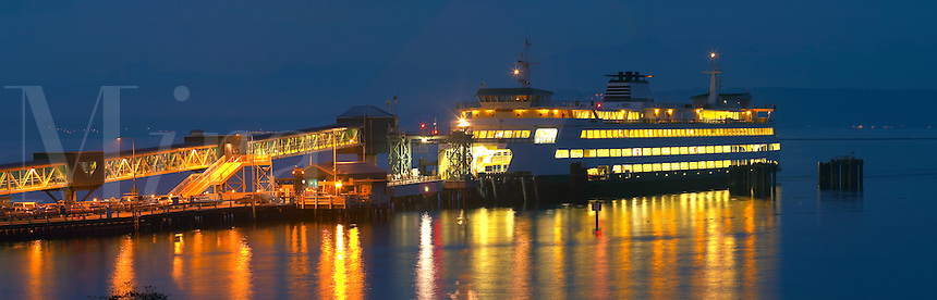 Washington State ferry Puyallup pulling into dock at night, Edmonds, Snohomish County, Washington, USA
