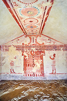 """Underground Etruscan tomb Known as """"Tomba Cardarelli"""" A single chamber with double sloping ceiling decorated with circles. In the tympanium has a scene of fighting animals below which is a flute player, a male figure holding a kylix. 510-500 BC. Excavated 1959 , Etruscan Necropolis of Monterozzi, Monte del Calvario, Tarquinia, Italy. A UNESCO World Heritage Site."""