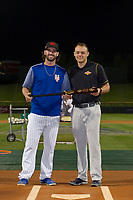 Tomas Nido (7), of the Scottsdale Scorpions is presented with the Zinger Bats First Place Award Bat by Jake Hirschman after winning the National League bracket in the Arizona Fall League Bowman Hitting Challenge on October 21, 2017 at Sloan Park in Mesa, Arizona. Chris Paul (not shown), of the Minnesota Twins organization, won the American League trophy while Tomas Nido, of the New York Mets organization, won the National League trophy. (Zachary Lucy/Four Seam Images)