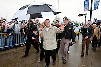 January 01, 2010:   Florida State head coach Bobby Bowden with his wife Ann makes his final walk to the stadium as he greets the fans and former players before the start of the Konica Minolta Gator Bowl College football game between the West Virginia Mountaineers and the Florida State Seminoles played at the Jacksonville Municipal Stadium in Jacksonville, Florida on January 01, 2010.  Florida State is making it's 28th consecutive bowl appearance with today's game.