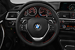 Car pictures of steering wheel view of a 2020 BMW 4 Series 430i Gran Coupe 5 Door Hatchback