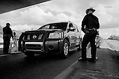 Nogales, Arizona.USA.October 24, 2006..The US border patrol monitors the main highway from Nogales to Tucson by placing check points along it. Vehicles are stopped and some randomly searched.
